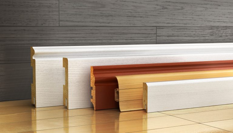 Set,Of,Skirting,Different,Form,On,A,Wood,Background.,3d